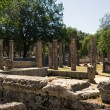 Ancient columns and ruins in Olympia, Greece — Stock Photo