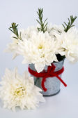 White flowers and sprigs of rosemary in a small tin pail — Stock Photo