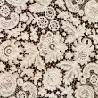 Beautiful fine white lace on a dark background — Stock Photo