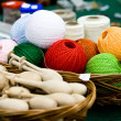 Multi-colored bright skeins of thread and bobbin — Stock Photo