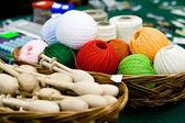 Multi-colored bright skeins of thread and bobbin — Stock Photo