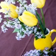 Stock Photo: Bouquet of spring flowers on yellow vase