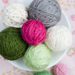 Lot of bright balls of knitting on background — Stock Photo #38665257