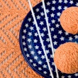 Orange balls, knitted pattern and knitting nedles — Stock Photo #38665259