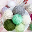 Stock Photo: Lot of bright balls of knitting on background