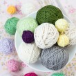 Lot of bright balls of knitting on background — Stock Photo #38665291