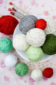 A lot of bright balls of knitting on the background — Stock Photo