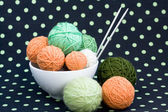 A lot of bright balls for knitting on a dark background — Fotografia Stock