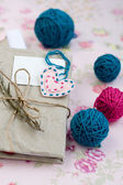 Old notebook with a dry branch of rosemary for love notes and bright balls of yarn — Stock Photo