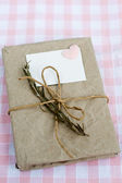 Old notebook with a dry branch of rosemary for love notes — Stock Photo