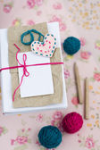 Old notebook for love notes and bright yarn balls — Stock Photo