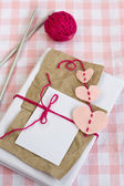 Old notebook for love notes, bright yarn balls and knitting needles — Stock Photo