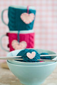Bright balls of yarn in blue plates and heart made — Stock Photo
