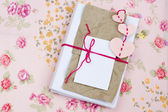 Old notebook for love notes on floral background — Stock Photo
