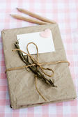 Old notebook for love notes on floral background — Stockfoto