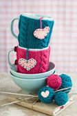 Bright balls of yarn in blue plates and heart made — Stok fotoğraf