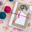 Old notebook for love notes, bright yarn balls and needles — Stock Photo #39566245