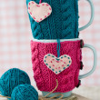Two blue cups in blue and pink sweater with felt hearts — Stock Photo #39569165