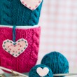 Two blue cups in blue and pink sweater with felt hearts — Stock Photo #39569169