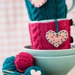 Two blue cups in blue and pink sweater with felt hearts — Stock Photo #39569173