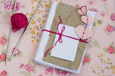 Old notebook for love notes, bright yarn balls and needles — Стоковое фото