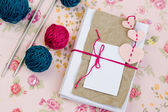 Old notebook for love notes, bright yarn balls and needles — Stock Photo