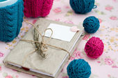 Two blue cups in blue and pink sweater with ball — Стоковое фото