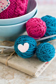 Bright balls of yarn in blue plates — Stock Photo