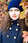 Portrait of young beautiful brunette in blue beret — Stock Photo