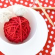 Stock Photo: Bright balls of yarn and knitting needles on polkdot background