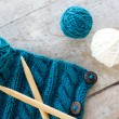 Stock Photo: Knitting pattern and needles on wooden background