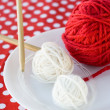 Stock Photo: Bright balls of yarn and knitting needles on background