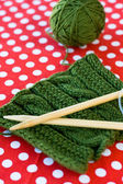 Knitted pattern and spokes on a polka dot background — Stock Photo