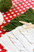 Knitted patterns and spokes on a polka dot background — Stock Photo