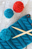 Knitting pattern and needles on a wooden background — Stock Photo