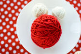Bright balls of yarn on a polka dot background — Stock Photo