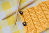 Knitting pattern and needles on a background — Stock Photo