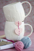 Two white cups of bright balls of yarn for knitting — Стоковое фото