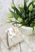 Bouquet of delicate pink tulips on a wooden background and vintage notebook for records — Stockfoto