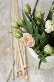 Bouquet of delicate pink tulips with knitting needles and yarn balls — Stock Photo