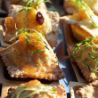 Deep fried Duck Ravioli with mango and papaya chutney - Stock Photo