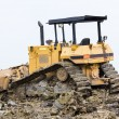 Stock Photo: Bulldozer in construction site