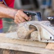 Carpenter working with electric planer — Foto Stock #14445909