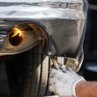 Stock Photo: Repairing exhaust pipe