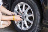 Car wheel changing — Stock Photo