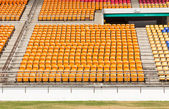 Rows of empty plastic stadium seats — Stock Photo