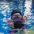 Girl swimming wearing goggles — Stock Photo