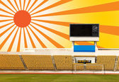 Stadium with scoreboard and sun ray — Stock Photo