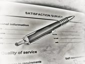 Pen laying on a customer satisfaction form — Stock Photo