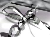 Close-up of a gift box (ribbon and bow) — Stock Photo
